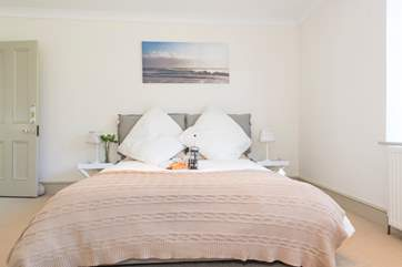 The ground floor double bedroom has a top quality five-foot mattress feather duvets, pillows and luxury bed linens.