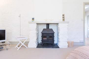 The bedroom has a wood-burner effect gas stove, as does the living-area.