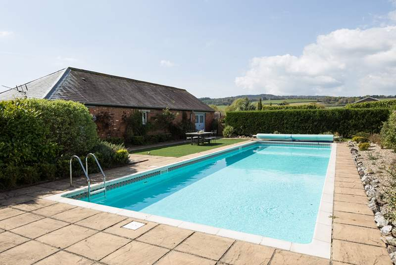 Anyone for a dip in this fabulous heated swimming pool? The pool and hot tub enclosure are a short 50m walk from the property's front door.