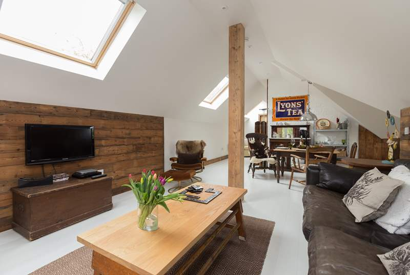 The fabulous open plan layout is exceptionally spacious, with painted floorboards, high sloping ceiling and plenty of light. A stunning bolthole.