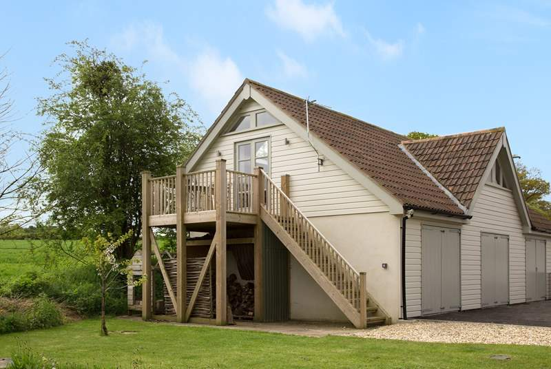 This is the perfect place to escape to for a break. Very peaceful and with the balcony looking out over countryside. The garages below are just used for the owners' classi cars so you do not need to