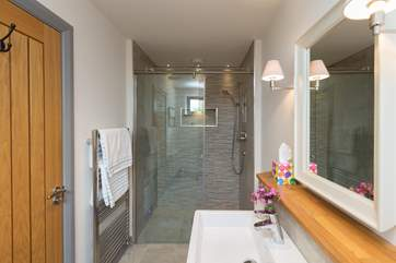 The en suite wet-room for the ground floor bedroom  with its double size walk-in shower.