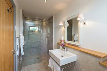 The ensuite shower room has a super-size walk in shower