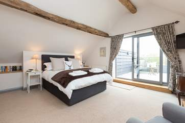 This is the first floor bedroom - sit in this luxurious kingsized bed with its own balcony and amazing panoramic views.