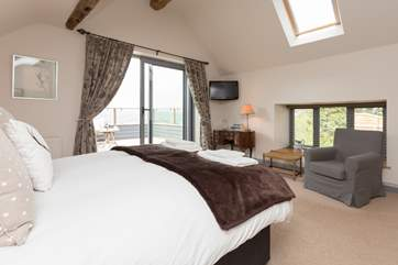 This is another view of the first floor bedrom - you can lie in bed and enjoy the view beyond the balcony before setting off to explore.