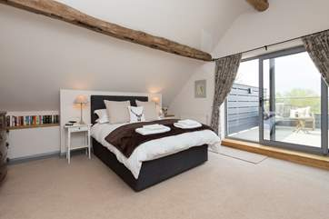 This is the first floor bedroom - with its fantastic private balcony and views for miles quite literally.