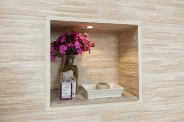 Clever alcove designs make the most of the space in the already large shower!