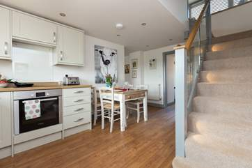 The modern kitchen/dining-room leads from the entrance hall.