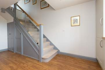 To the side of the kitchen/dining room are the  stairs to the first floor bedroom.