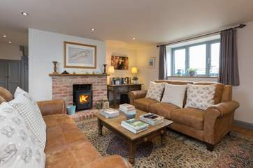 The sitting-room is the perfect place to relax, with deep comfortable antiqued leather sofas and a cosy wood-burner with all your wood provided.
