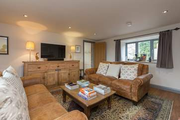 After a day of fresh air, the comfy sofas invite you to put your feet up; a Smart TV is at one end of the sitting-room, the wood-burner is at the other.