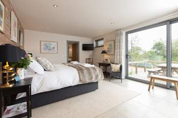 Both bedrooms are super-luxurious. This is the ground floor bedroom with access to the deck and with stunning views.