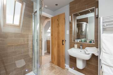 The very modern en suite shower-room, with large heated towel rail for toasty snug towels.