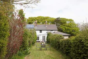 The quiet location makes al fresco dining perfect in the cottage garden
