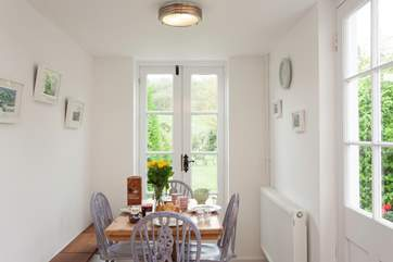 Sit everyone around the country style, wooden, dining table and enjoy a lovely meal together