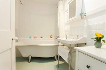 The family bathroom with claw foot bath is a lovely quiet spot to run a bubble bath, grab a book and drink a glass of wine