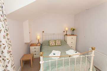 The double bedroom has a lovely cottage feel in keeping with the rest of the house