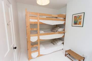 The triple bunk beds is an exciting feature for the children!