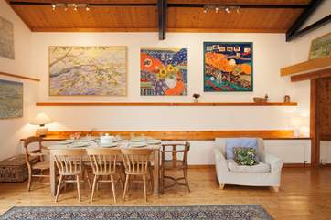 The owner's artwork decorates the Studio, bringing life and colour throughout the barn