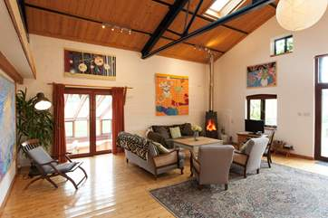 In the living room you get the true barn conversion feel, with high ceilings and wood-burning stove you can expect ultimate cosiness