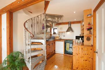 The unique spiral staircase is a lovely feature in the middle of the property