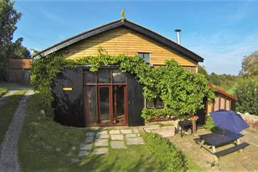 The Studio is a three bedroom barn conversion in the middle of the countryside.