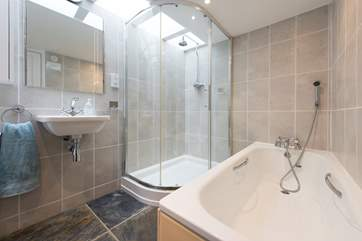 The ground floor bathroom houses a shower cubicle too.
