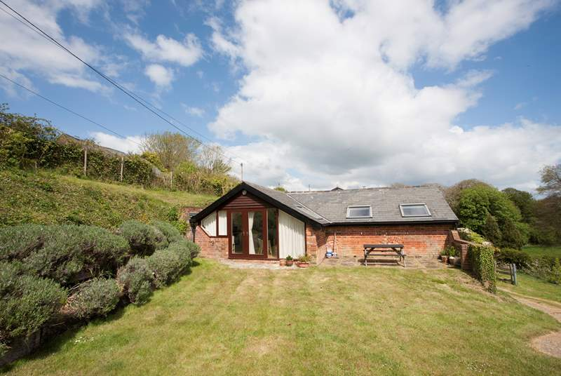 Although not enclosed, The Piglet has a lovely large lawn area for the kids to run around on
