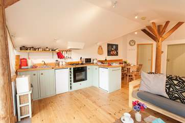 In the centre of the open plan living space, the Owner has made a beautiful pillar, bringing character and charm to the barn conversion