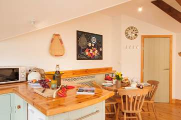 The kitchen/dining area is full of light with a cosy cottage charm, a lovely place for a spot of breakfast in the morning.