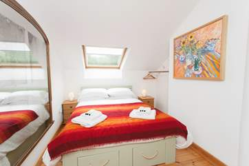The double bedroom has fantastic views across the orchard and fields,completed with a lovely vintage mirror.