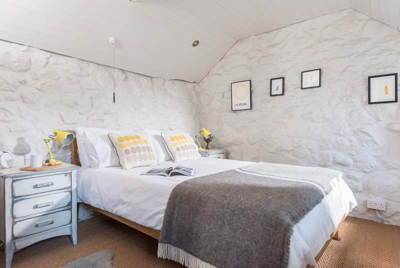 The gorgeous bedrooom is decorated in calm greys complemented with crisp white and fresh yellows.