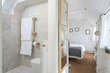 The fabulous open shower-room is next to the bedroom.
