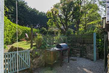 To the side of the cottage is your barbecue area and a gate leading to the boules court.