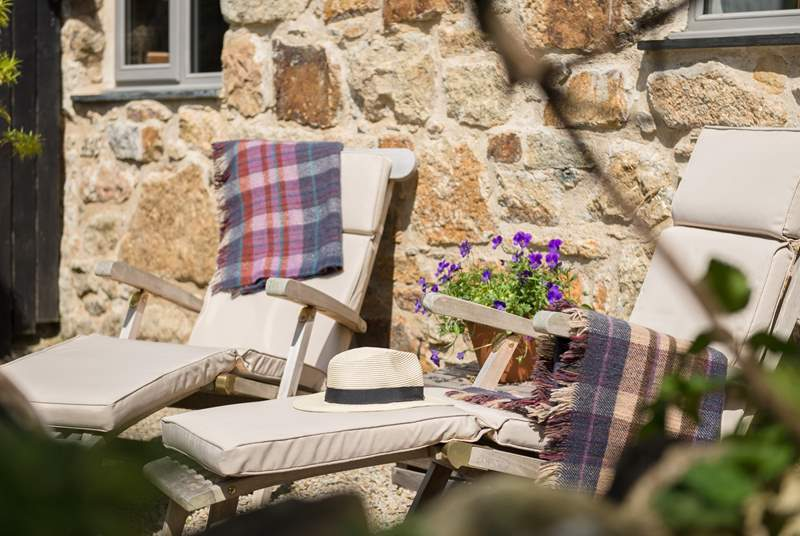 Comfy relaxing chairs, perfectly placed to enjoy the peaceful surroundings.