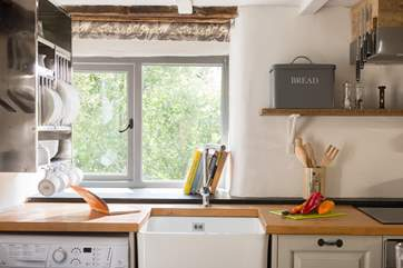 The hand-built kitchen with butler sink has views across the gardens.
