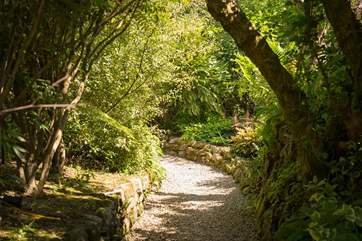 Follow the pathway through the lush gardens to find Carter's Croft passing Smugglers Lane and The Old Granary on your way (approx 200 yards).