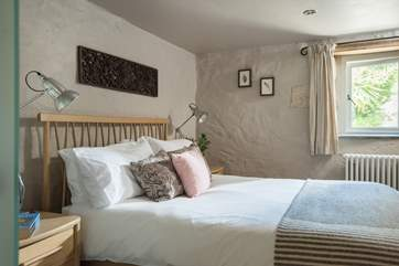 Calm colours throughout this lovely bedroom at the front of the cottage.