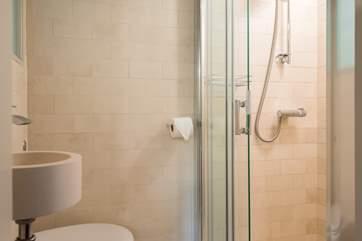 The fully tiled en suite shower-room.