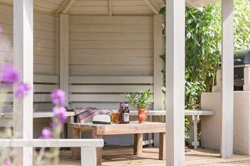 Sit under the garden gazebo with friends and family.