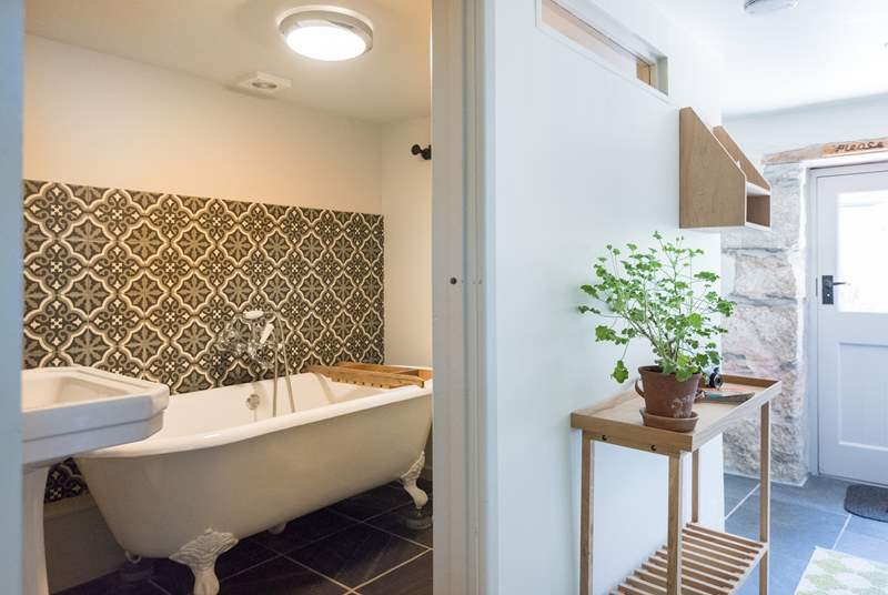The family bathroom with gorgeous cast iron roll-top bath is on the ground floor.