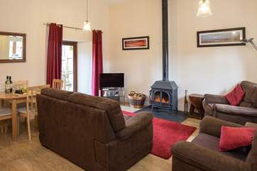Warm and comfy living and dining areas with a lovely wood-burner, perfect for those cosy nights in.