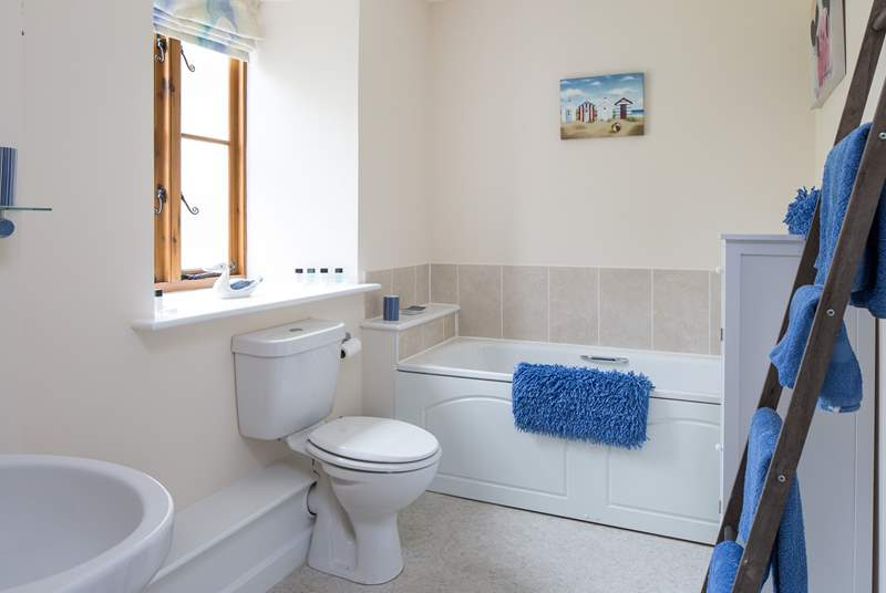 Family bathroom with bath and shower cubicle.