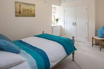 Light and airy main bedroom. Super comfy bed awaits you at the end of a long day exploring.