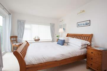 This gorgeous downstairs double bedroom has doors out the garden, a great bonus for those sunny days