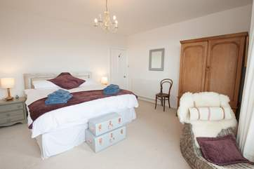 The spectacular master bedroom has a chaise longue to enjoy the lovely sea views,