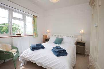 The second double bedroom, on the first floor, also benefits from stunning sea views