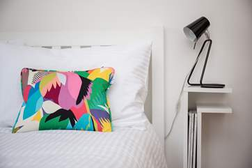 Vibrant colours flow through the second bedroom.