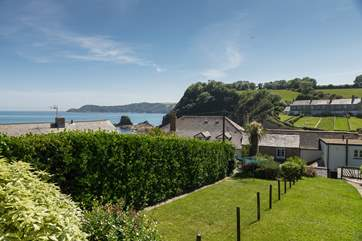 Enjoy the coastal views from the decking at the far end of the garden.