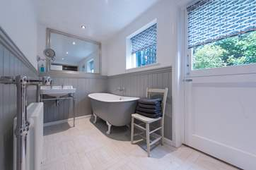 The gorgeous bathroom with a large walk-in shower at the other end.